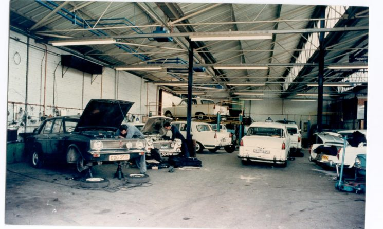 Police Vehicle Workshops at Cole Avenue Gloucester. Shows staff at work on Austin Westminster Patrol cars, Austin 1100 Panda cars and Hillman Minx car (Criminal Investigation Department) 1960. (Gloucestershire Police Archives URN 1166)