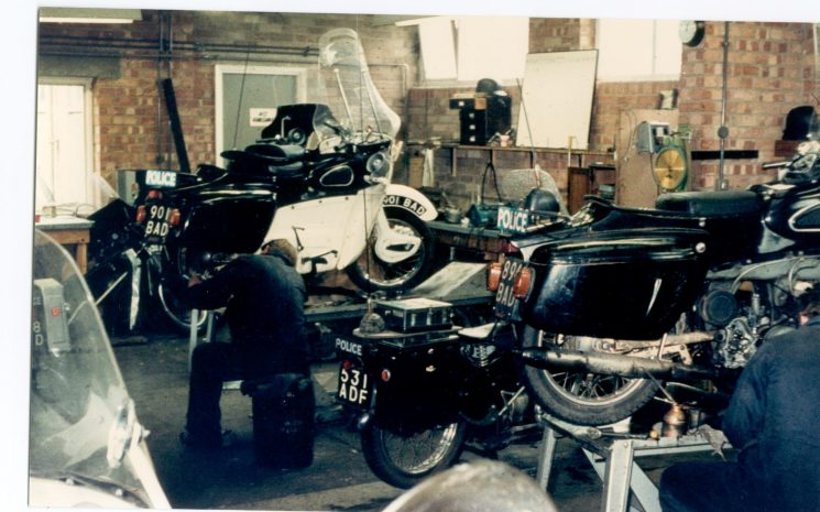 Police Motorcycle Workshops at Police Headquarters. showing 2 Ariel Leaders (2 stroke twin) and 1 Velocette LE (water cooled four stroke) motorcycles 1960. Stuart Purves left, Ron Hyett right. (Gloucestershire Police Archives URN 1168)