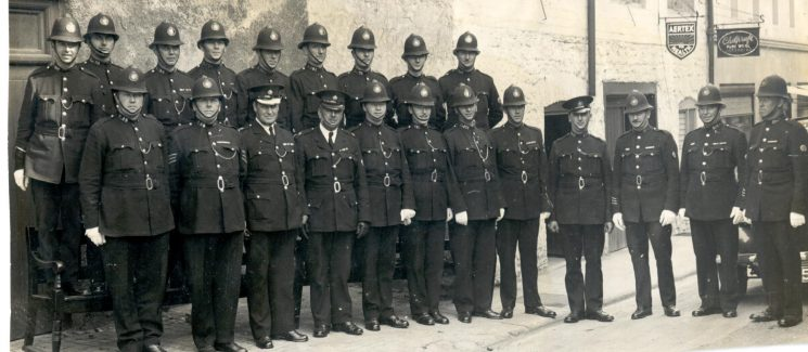Staff at Chipping Campden 1937. Includes: Police Sergeant Bridges, Superintendent Williams, Police Sergeant Bryant Front row: first left Police Constable Stan Long. Second from right John Meadows. (Gloucestershire Police Archives URN 133)