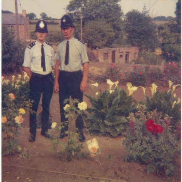 Two officers in uniform one wearing helmet with old style badge and the other wearing a new style helmet badge. (Gloucestershire Police Archives URN 1400)