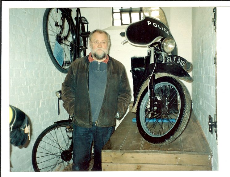 Retired Motor cycle Workshop Foreman Mike Rowles at Tetbury Museum with police Velocette motorcycle which he had restored. (Gloucestershire Police Archive URN 1462 )