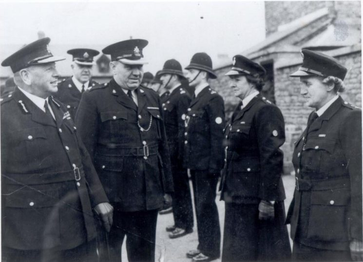 Her Majesties Inspector,Chief Constable Henn,  Deputy Chief Constable A. H. Carter, Superintendent. J. Hallam and other ranks; Woman Police Constables Brimble and Lodge; (Gloucestershire Police Archives URN 150)