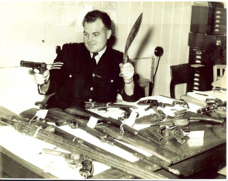Police Sergeant Michael Barrett with weapons handed in during a Firearms Amnesty. (Gloucestershire Police Archives URN 1622)