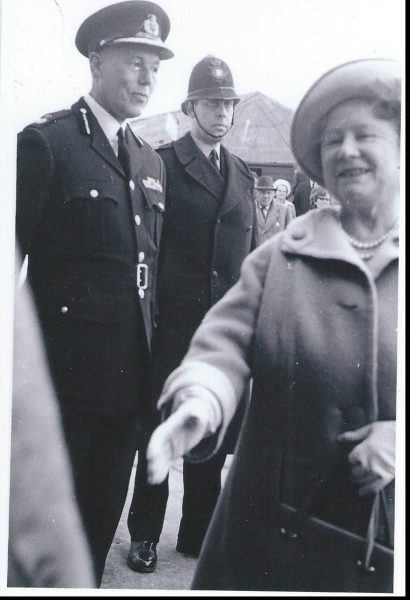 """Cheltenham Races,  Gold Cup circa 1968. Chief Constable E.P.B. White, Her Majesty the Queen Mother & Police Sergeant 520 Peter Hillier. Martyn Hillier tells the following story. My father joined on 29th October 1949 and was a issued a """"new number"""", by which I mean previously unissued; 520. When I joined I was issued 1144. Sadly shortly afterwards my father died and at the funeral the Chief Constable asked my mother and I if I would like my father's number. Naturally we said yes, so I changed numbers. The Shire Hall payroll system had a problem with this, which to be fair, was a pretty unusual set of circumstances. As a consequence my pay the next month was rather good; top rate Sergeant with full Rent Allowance. The next month, after deduction of the overpayment, I had something like £5 !! (Gloucestershire Police Archives URN 1827) 