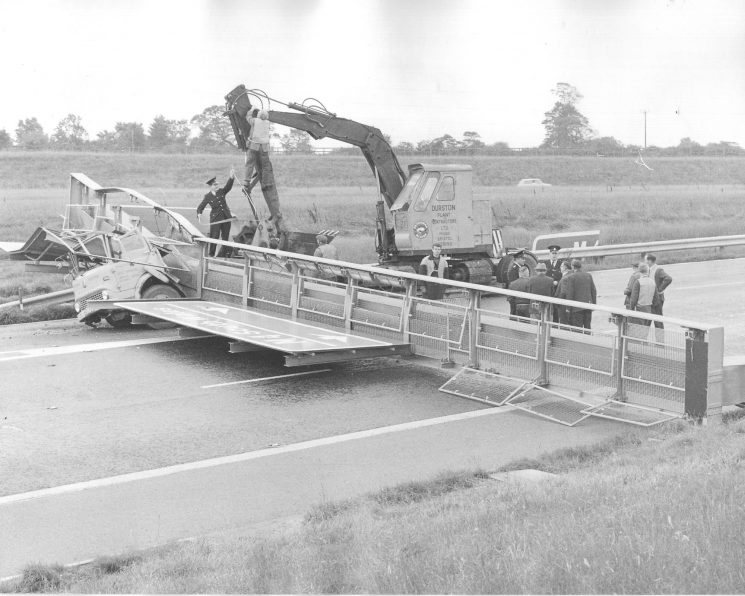 Road accident involving a lorry having collided with a barrier on the M4. Photos believed to be of when the M4 to South Wales was under construction in the early 1960s. (Gloucestershire Police Archives URN 1907-1)