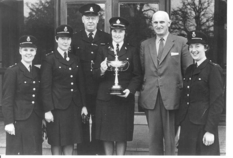 Winning First Aid team in 1969. Left to right: Woman Police Constable Hall, Woman Police Constable  M. Juggins, Police Sergeant Griffiths: Woman Inspector M. Gibson, Deputy Chief Constable Smith, Woman Police Constable Davis. (Gloucestershire Police Archives URN 230)