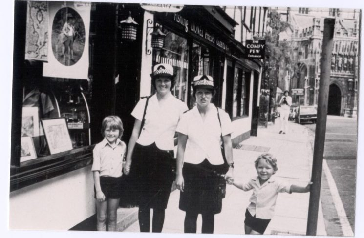 Woman Police Constables Jill Dobie (later Field) and Sarah Tavender with two children visiting Gloucester Cathedral  late 1970s. (Gloucestershire Police Archives URN 237)