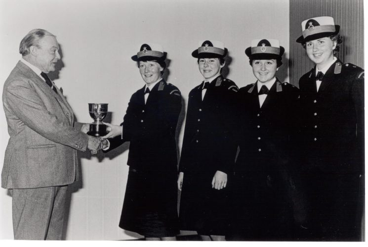 Award of Erskine First Aid Trophy to female police cadet team. Left to right: Cadets Alison Davidson-Long, Beverley Coles, Donna Ede and Bucknell being presented with Trophy by Commander of St Johns Ambulance Association 1978. (Gloucestershire Police Archives URN 275)