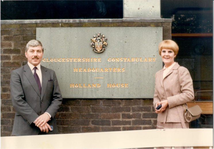 Detective Sergeant R. Hall and Detective Sergeant M. Hall at front of Police Headquarters - first husband and wife team in Gloucestershire to receive Police Long Service and Good Conduct medals. (Gloucestershire Police Archives URN 416)