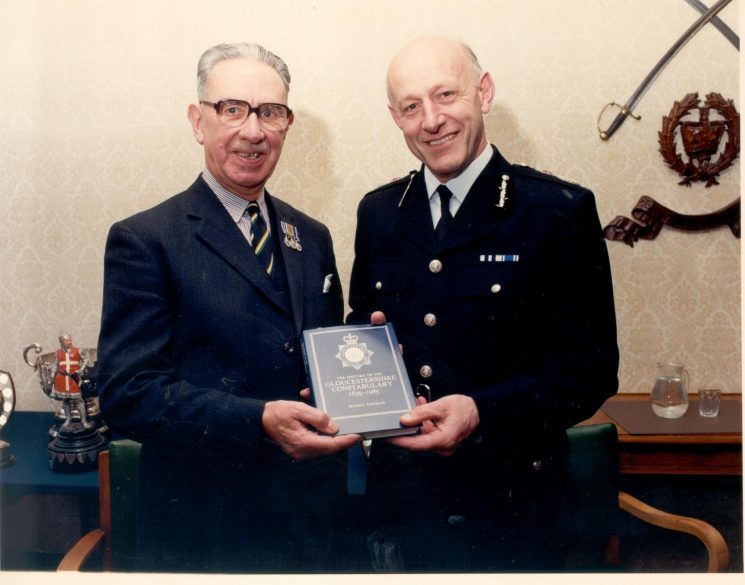 Presentation of book, History of the Gloucestershire Constabulary 1839 to 1985, by author Retired Chief Superintendent Harry Thomas Queens Police Medal to Chief Constable Albert Pacey Queens Police Medal. Much of the information for the Force Archives comes from this book. (Gloucestershire Police Archive URN 472)