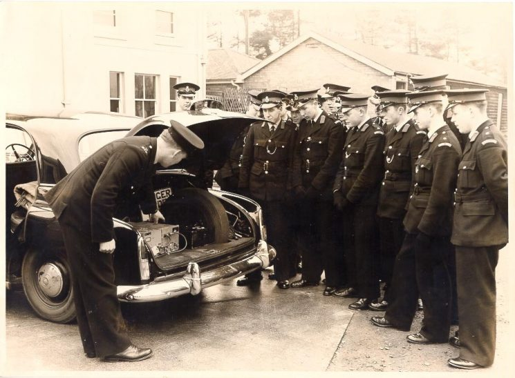 Humber Hawk patrol car with traffic officer and cadets. Far right Cadet Ralph Wilkins. (Gloucestershire Police Archives URN 628)