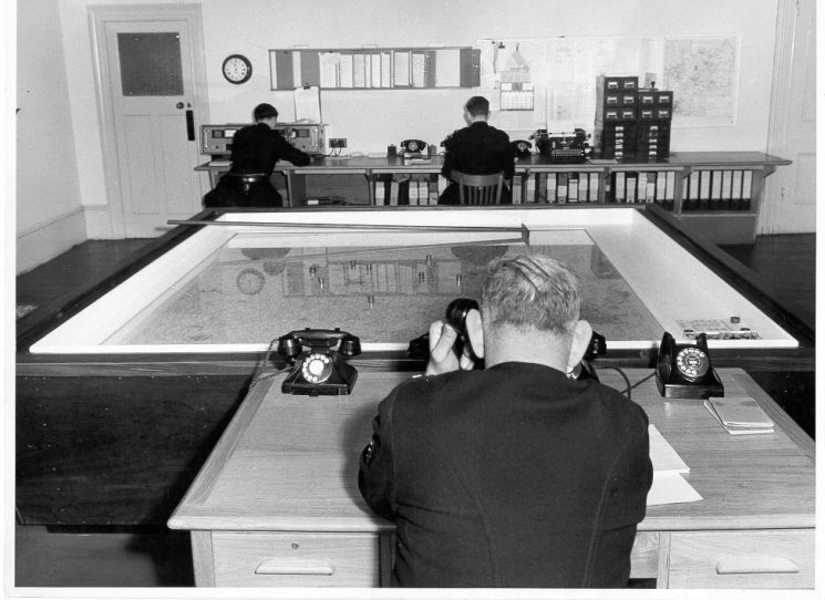 Headquarters Information Room - believed to be during the 1950s at Holland House Cheltenham. Police Constable Dick Brett in Foreground. (Gloucestershire Police Archives URN 631)