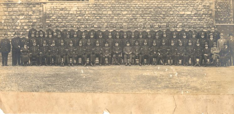 B Division Staple Hill 1925. Includes Police Constable 333 Henry Vickeridge back row left to right Number 16. Served in Army  in Great War joined Gloucestershire Constabulary 1919 posted to Tewkesbury and later Downend and Staple Hill around 1923.His son Denis born 1926 at Downend recalls his father being taken into Bristol Hospital with appendicitis from which he did not recover. Picture also shows Woman Sergeant Gale seated far left of group. (Gloucestershire Police Archive URN 709)