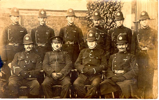 Tewkesbury  Police 1920 Back row: Police Constables 389 Claude Baglin, 95 Paddy Bird,  333 Henry Vickeridge, Police Constable from Coombe Hill, Police Constables 359 Jock Kerr, 4 Rogers Front row left to right: Police Constable from Twyning, (He has been awarded the Silver Braid) Inspector Durham, unknown , Police Constable 275 Tom Mitchell. (Gloucestershire Police Archives URN 711)
