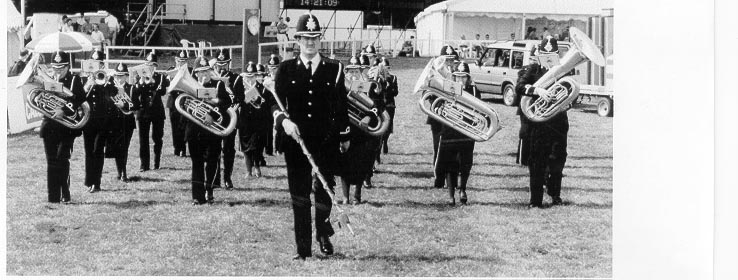 Band of the Gloucestershire Constabulary on parade at Gatcombe Park Horse Trials 1996. Police Constable Michael Steed carrying the mace in front of band. (Gloucestershire Police Archives URN 729)