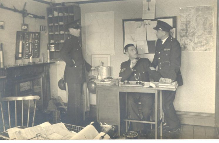 Filton Police Station showing Inspector W. Hart; Police Sergeant F. Statham and Fire Officer. (Gloucestershire Police Archives URN 786)