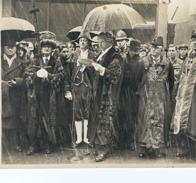 An unknown Civic event showing  Police Constable Tom Pittaway in crowd 1938. Doing the day job in all weathers. (Gloucestershire Police Archive URN 923)