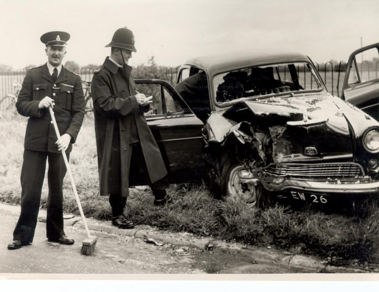 Police Constables Les Skuse and Ken Barker  dealing with a road traffic accident at junction of A46 and A420. (Gloucestershire Police Archives URN 936-1)