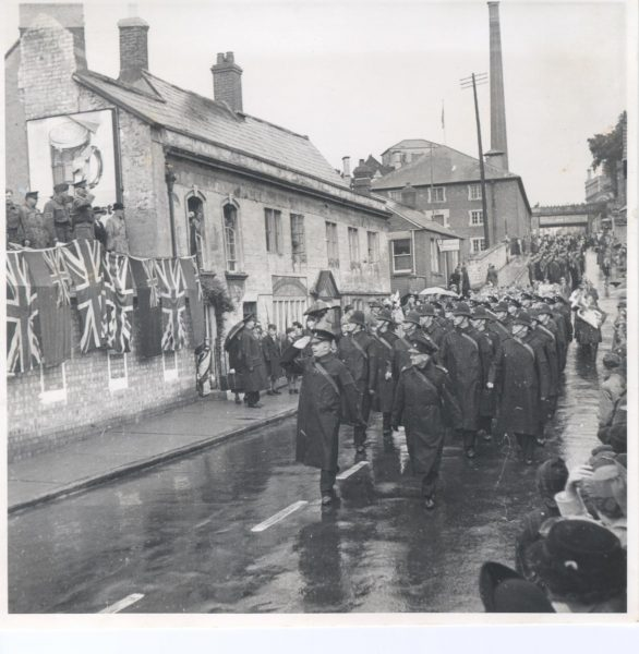 Police contingent marching from Lansdown to Stroud Rugby Ground at Lightpill, during War Weapons week to raise funds for a Spitfire aircraft. Inspector Ted Herbert leading the parade, Police Sergeant Crowther in front rank on left, to his right Police Constable  Arthur Cleveland and Police Constable  Les Rowell 1941. (Gloucestershire Police Archives URN 966)