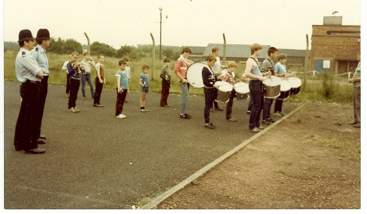 Police Constables Statham and Manning watching the Junior Colliery Band during duty at the Miners' Strike Harworth, North Notts, July 1984. (Gloucestershire Police Archives URN 982)