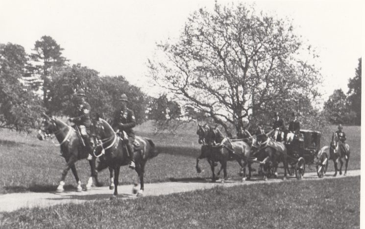 Mounted officers escorting the carriage of King George V through Cirencester Park in the early 1930s. H. Watkins at the back. (Gloucestershire Police Archives URN 2114)