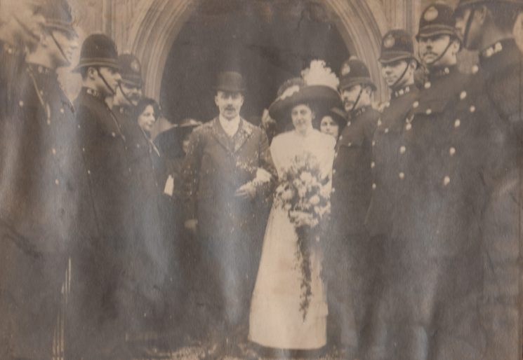 Constables forming a guard of honour as the bride and groom leave church. Believed to be around 1910. (Gloucestershire Police Archives URN 2110)