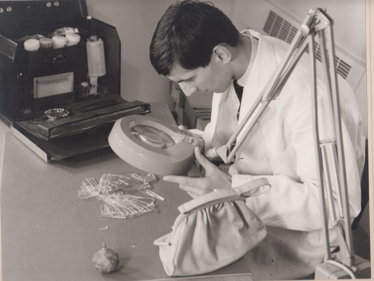 Police Constable Richard Griffiths  examining evidence in the laboratory, 1971. (Gloucestershire Police Archives URN 2102)