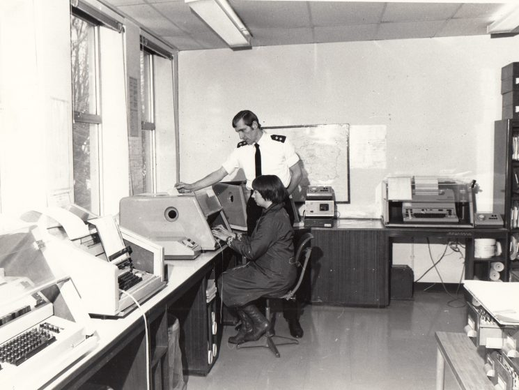 -Telecommunications Room Police Headquarters Cheltenham 1978. Inspector Bruce Smith and Lynn Richings telex operator. (Gloucestershire Police Archives URN 2083)