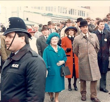 Her Majesty the Queen Mother at Cheltenham Races. 1980s. Also in photo is Police Constable Martin Oxley. (Gloucestershire Police Archives URN 615)