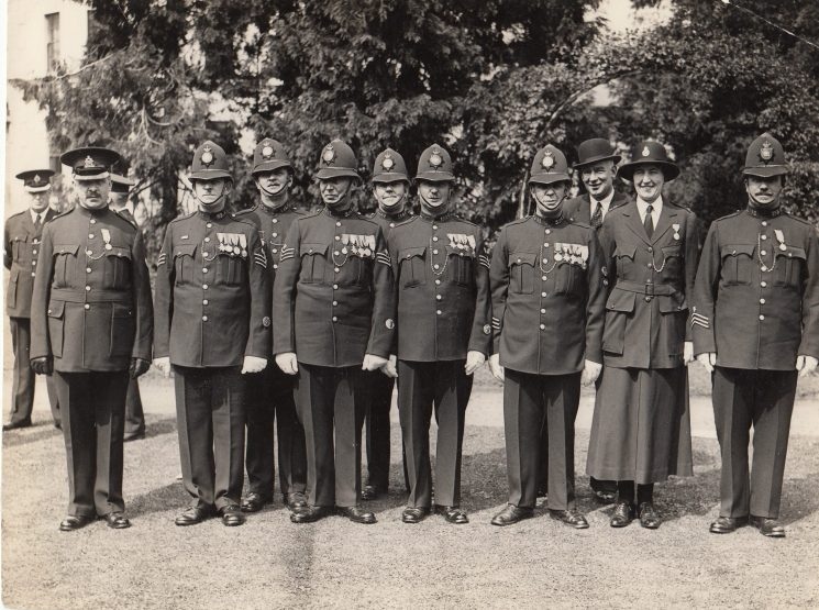 Coronation medals 1937. Rosa Rouse and officers with Collar numbers visible 62,35,187,33,152. (Gloucestershire Police Archives URN 2111)