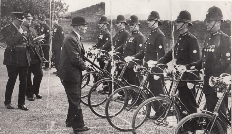 Police Constables  on parade with bikes collar numbers visible 243, 147, 174, 183,148 (Gloucestershire Police Archives URN 2226)