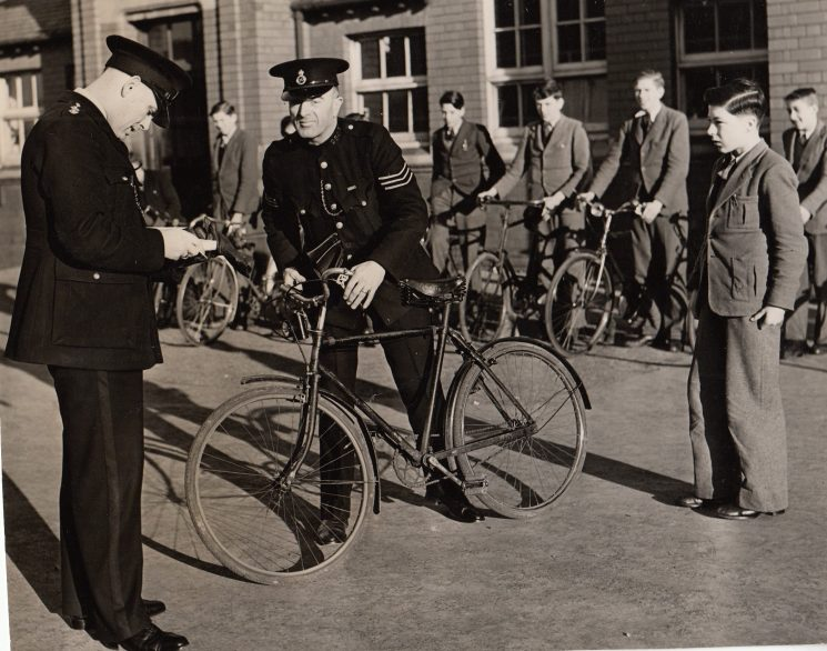 Police Sergeant Cyril Milner and Inspector H.Jack Greenall checking school boys bikes 1947. (Gloucestershire Police Archives URN 2097)