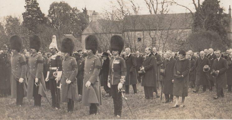 Soldiers wearing black arm bands in churchyard, location unknown, after the First World War? (Gloucestershire Police Archives URN 2230)