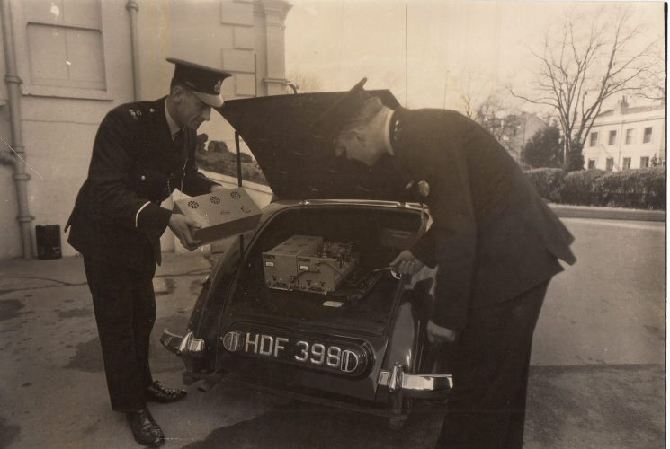 2 police officers installing a radio set into the boot of a Riley RM patrol car HDF 398 at police HQ's Lansdown Road, Cheltenham. According to a reliable source this registration number was issued between April and July 1948. Police Constables thought to be Ron Wilden & George Workman. (Gloucestershire Police Archives URN 2090)