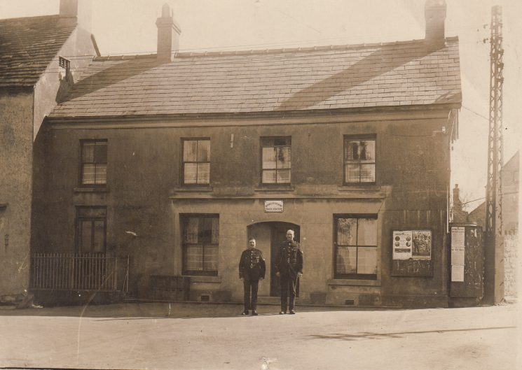 Police ConstableBeddis outside Woolaston/Bream police station. (Gloucestershire Police Archives URN 2078-2 )