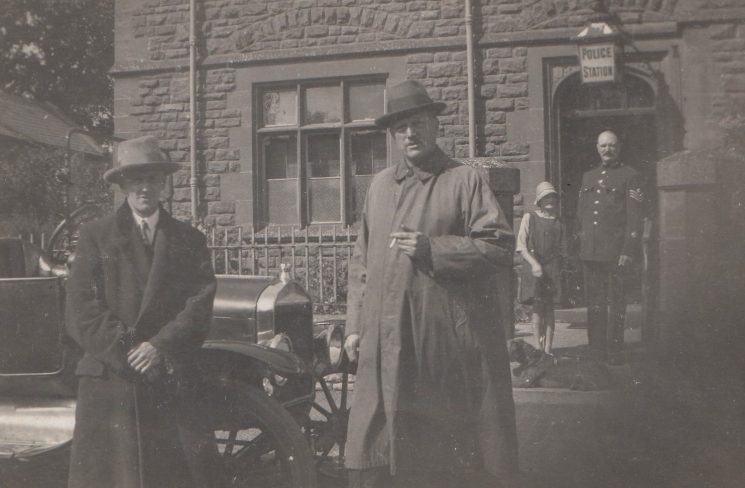 Officers and car  at entrance of  police station. (Gloucestershire Police Archives URN 2118)