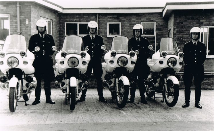 In April 1976 Gloucestershire Constabulary took delivery of four new BMW R75/6 750cc motorcycles. (MFH 199P to MFH 202P) It was the first force in the region to adopt the BMW, which was seen by some at the time as a controversial purchase, as there was still an ailing UK motorcycle industry. Within 18 months all Gloucestershire Traffic department motorcycles were BMW. Left  to Right;  Police Constables Andy Hampton, Martyn Hillier, Roger Merrett & Peter Maunder. (Gloucestershire Police Archives URN 2165) | Photograph from Martyn Hillier