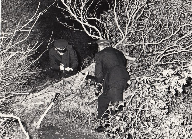 Police Officers removing a fallen tree blocking the road possibly brought down in the gales of October 1987. (Gloucestershire Police Archives URN 2091)