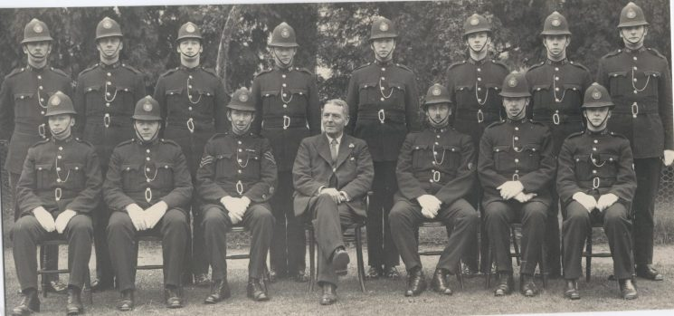 Recruits 1937 H Thomas, 438 Edward Day, R Wildin,156 Denis Holbrook, 439 Athol H Aston, 198 Jack Francis Kay, 175 Ronald Smith, B Sanders, 424 Richard  Stephens, 216 Walter Long, Police Sergeant Matt Wilmott, Deputy Chief Constable JWP Goulder, J Squire, 425 Sydney Barlow, 423 G Coates. (Gloucestershire Police Archives URN 112)