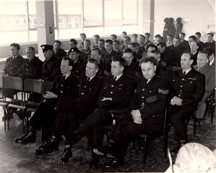 Police Dog Trials South Cerney 1960. Gloucestershire officers visible include Stan Gudge; Grahame Osbourne; Geoff Price; Phil Farmer; Pete Kilbey; Bert Smith; Barry Williams; Terry Short; Ivan Hoddy; Dave Mitchell; Terry Cole. (Gloucestershire Police Archives URN 2250)   Photograph from Pete Kilbey