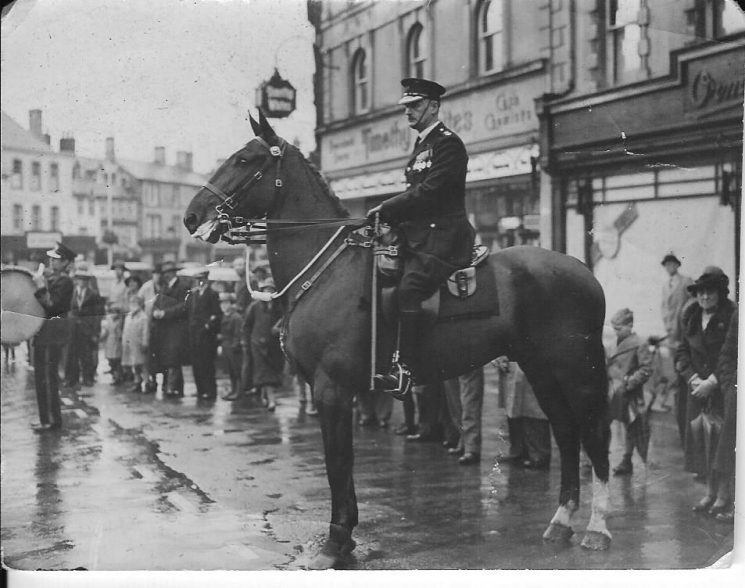 Superintendent Arthur W Hopkins mounted on horse at Armistice Day  parade Cirencester, 1936 (Gloucestershire Police Archives URN 2258)