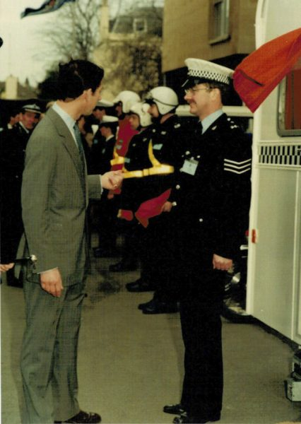 His Royal Highness the Prince of Wales talks to Police Sergeant Dave Thompson (DT) Behind are Police Constables Adrian Norton (goggles on helmet) Mike Vaughan and John Phelps (Gloucestershire Police Archives URN 2264) | Photograph from Martyn Hillier