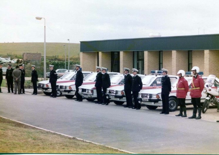 Her Majesty's Inspectorate visit to Bamfurlong early 1980s. From the left  talking to the visitors is Inspector Des Webb,Police Sergeant Roy Thomas, Police Constables Tony Birks, Garry Ashdown unknown,John Davies,Paul Biggs,  Trevor Jones, Police Sergeant Brian Bailey, Police Constable John Phelps. (Gloucestershire Police Archives URN 2209) | Photograph from Martyn Hillier