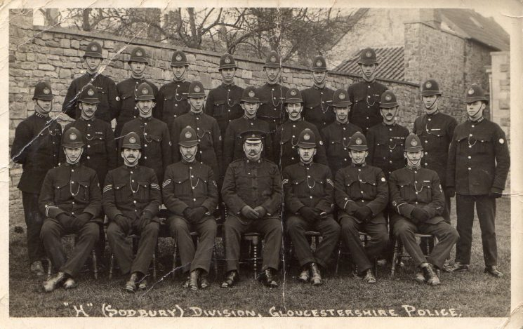 H (Sodbury) Division Identified from collar numbers so thought to be. Back Row from left to right: Edwin Gasside; unknown; Talbot Holland; Charles Chamberlain; James Whitehead; Frank Morgan; Richard Willis. Middle row left to right: Mark Miller; Stuart Hunt; William Wakefield; Thomas Clutterbuck; Frederick Treasure; Edgar Hitchings; unknown; Edward Harding; unknown; Henry Gale. Seated left to right: Frederick Ford; James Davey; unknown; unknown; Gilbert Simeon Williams; George Wickham; Frank Payne. (Gloucestershire Police Archives URN 1380)