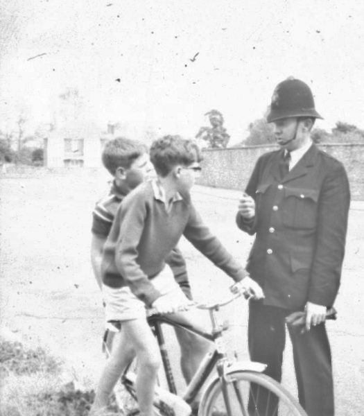 Police man talking to two children on a bike. (Gloucestershire Police Archives URN 2475) | Photograph from an old negative