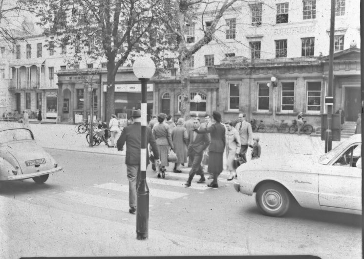 Policewoman on traffic duty  on a zebra crossing in Cheltenham Promenade. (Gloucestershire Police Archives URN 2471) | Photograph from an old negative
