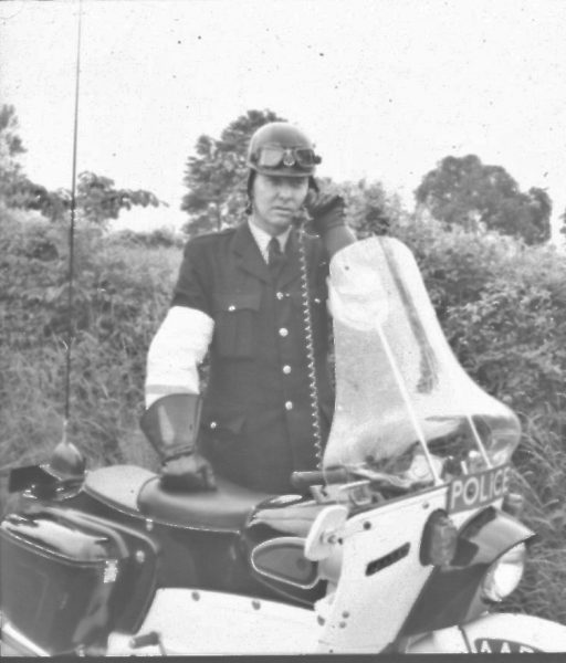 Police Constable Ken Price with Ariel Leader motor bike making a call on his radio. (Gloucestershire Police Archives URN 2477) | Photograph from an old negative