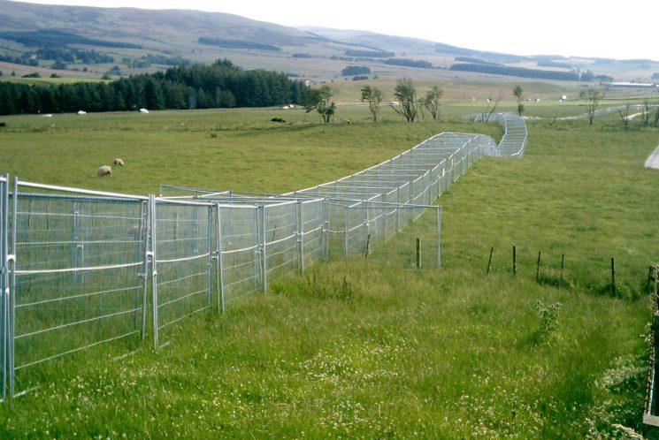 The G8 Summit held at Gleneagles Scotland, where officers from all over the UK supplied Firearms and auxiliary staff to assist. G8 Summit  Gleneagles Scotland View of the Protective fencing surrounding Gleneagles. (Gloucestershire Police Archives URN 2363) | Photograph from John Taylor