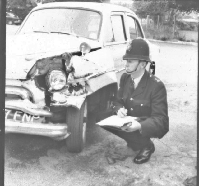 Police Constable Fred Gardner taking details after a road traffic collision. (Gloucestershire Police Archives URN 2460) | Photograph from an old negative