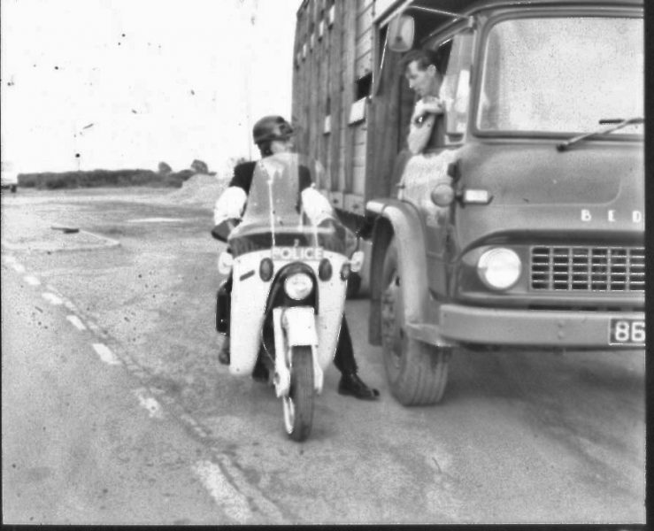 Police Constable Ken Price on an Ariel Leader talking to a lorry driver. (Gloucestershire Police Archives URN 2486) | Photograph from an old negative